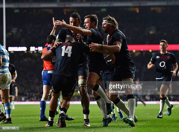 Jonny May of England celebrates with team mates after he scored his sides second try during the Old Mutual Wealth Series match between England and...