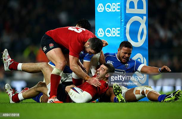 Jonny May of England celebrates with teammate Brad Barritt of England after scoring a try during the QBE international match between England and...