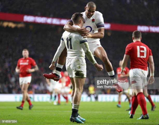 Jonny May of England celebrates with teammate Jonathan Joseph after scorings his sides first try with during the NatWest Six Nations round two match...