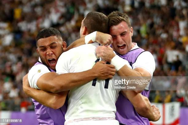 Jonny May of England celebrates with teammates after scoring his team's second try during the Rugby World Cup 2019 Quarter Final match between...