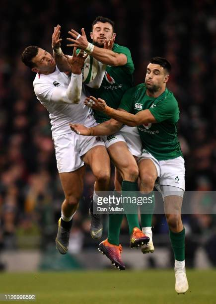 Jonny May of England competes in the air against Robbie Henshaw and Conor Murray of Ireland during the Guiness Six Nations match between Ireland and...