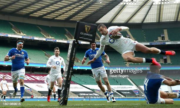 Jonny May of England dives over Luca Sperandio of Italy to score their side's third try during the Guinness Six Nations match between England and...