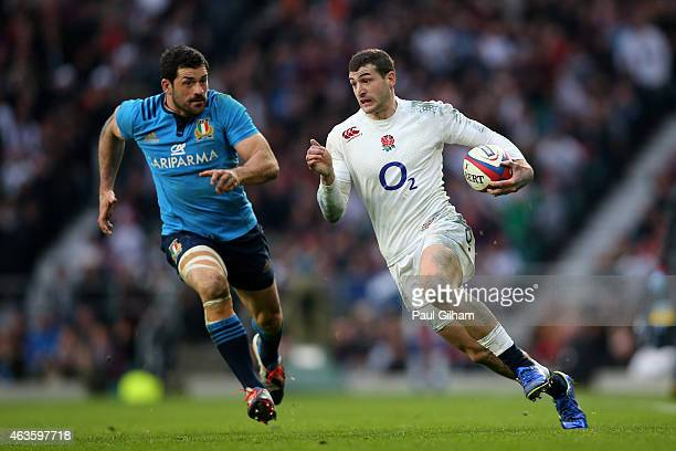 Jonny May of England goes past Andrea Masi of Italy during the RBS Six Nations match between England and Italy at Twickenham Stadium on February 14...