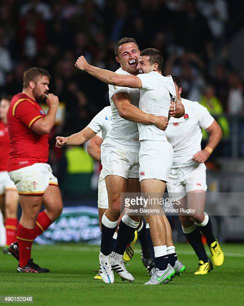 Jonny May of England is congratulated by Sam Burgess of England after scoring the first try during the 2015 Rugby World Cup Pool A match between...