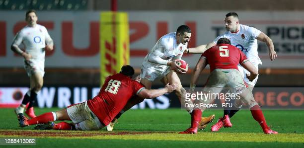 Jonny May of England is held by Tomas Francis during the Quilter International match between Wales and England as part of the Autumn Nations Cup at...