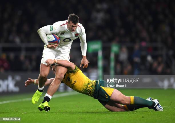 Jonny May of England is tackled by Bernard Foley of Australia during the Quilter International match between England and Australia at Twickenham...