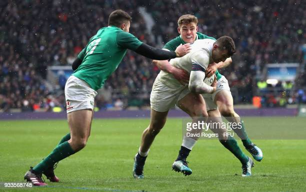 Jonny May of England is tackled by Garry Ringrose and Jacob Stockdale during the NatWest Six Nations match between England and Ireland at Twickenham...