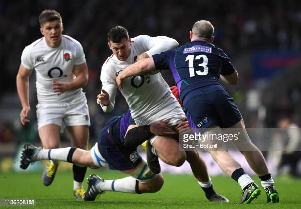 Jonny May of England is tackled by Grant Gilchrist and Nick Grigg of Scotland during the Guinness Six Nations match between England and Scotland at...