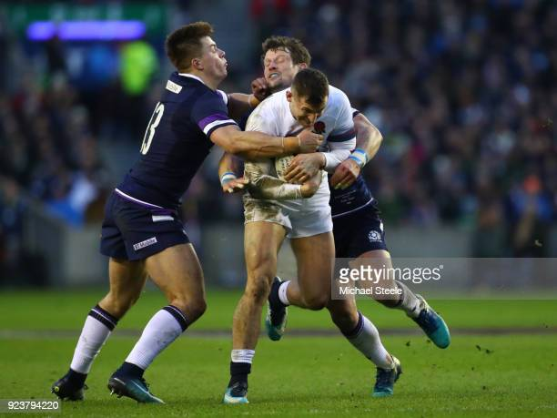 Jonny May of England is tackled by Huw Evans and Peter Horne of Scotland during the NatWest Six Nations match between Scotland and England at...
