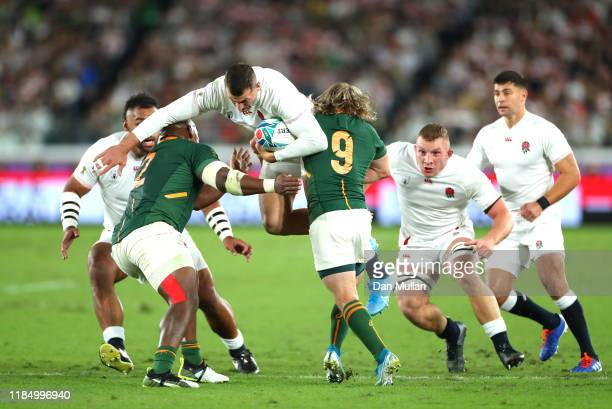 Jonny May of England is tackled by Mbongeni Mbonambi and Faf de Klerk of South Africa during the Rugby World Cup 2019 Final between England and South...