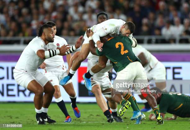 Jonny May of England is tackled by Mbongeni Mbonambi of South Africa during the Rugby World Cup 2019 Final between England and South Africa at...