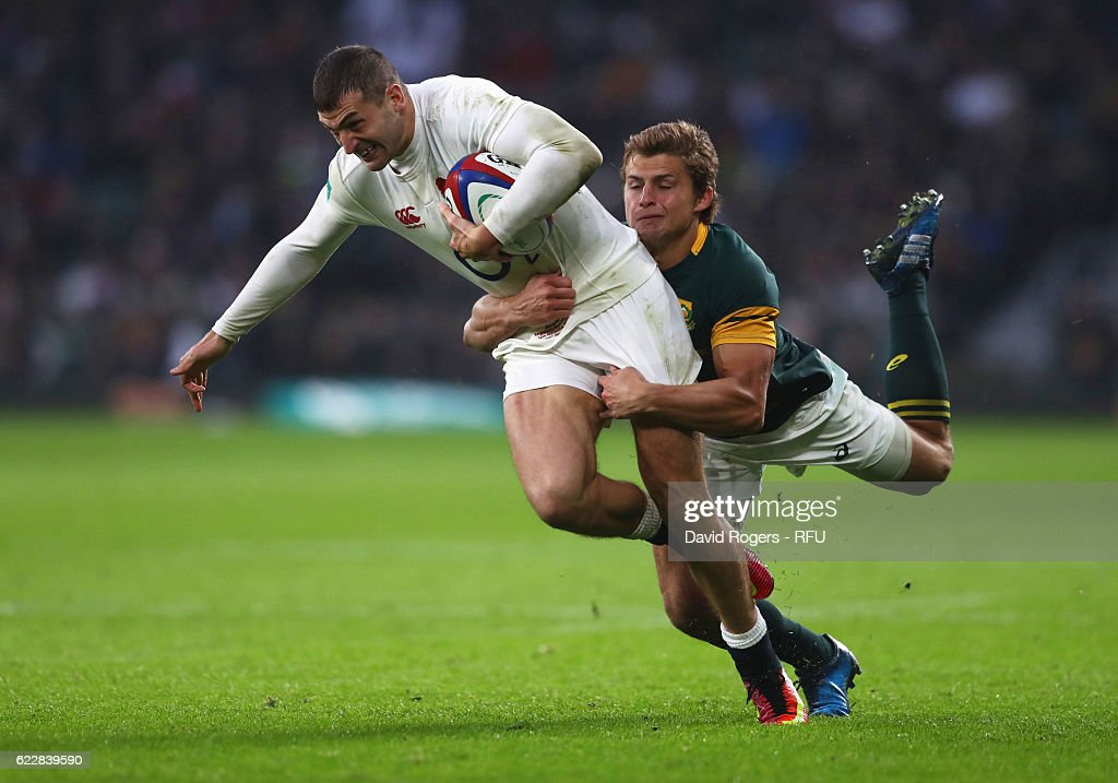 Jonny May of England is tackled by Pat Lambie of South Africa during the Old Mutual Wealth Series match between England and South Africa at Twickenham Stadium on November 12, 2016 in London, England.