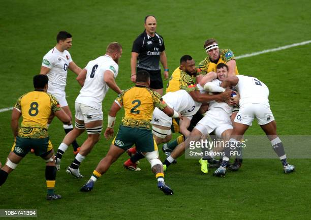 Jonny May of England is tackled by the Australian defence during the Quilter International match between England and Australia at Twickenham Stadium...
