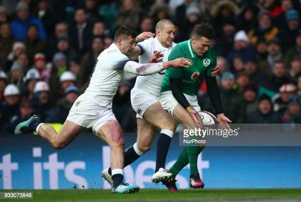 LR Jonny May of England Mike Brown of England can't stop Ireland's Jacob Stockdale to go over during NatWest 6 Nations match between England against...