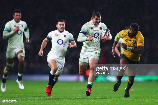 Jonny May of England runs at the Australia defence during the Old Mutual Wealth Series match between England and Australia at Twickenham Stadium on...