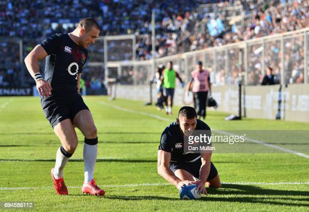 Jonny May of England scores his sides second try of the game during the International Test match between Argentina and England at Estadio San Juan...