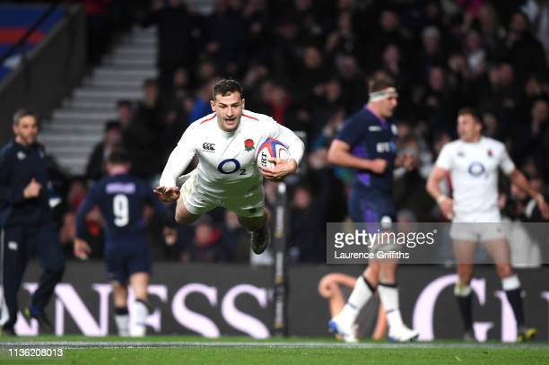 Jonny May of England scores his team's fourth try during the Guinness Six Nations match between England and Scotland at Twickenham Stadium on March...