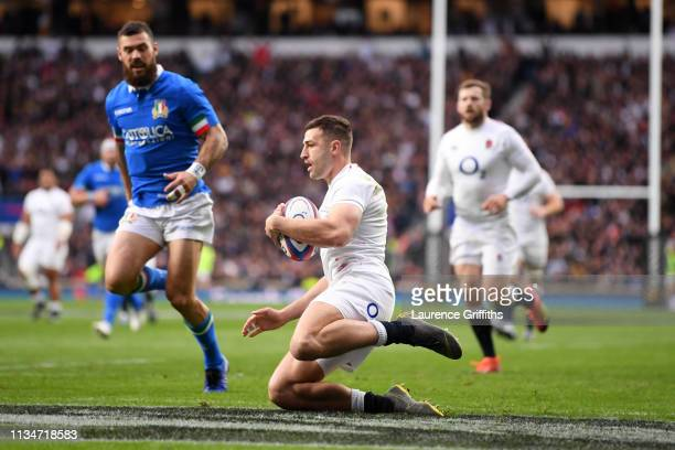 Jonny May of England scores his team's second try during the Guinness Six Nations match between England and Italy at Twickenham Stadium on March 09...
