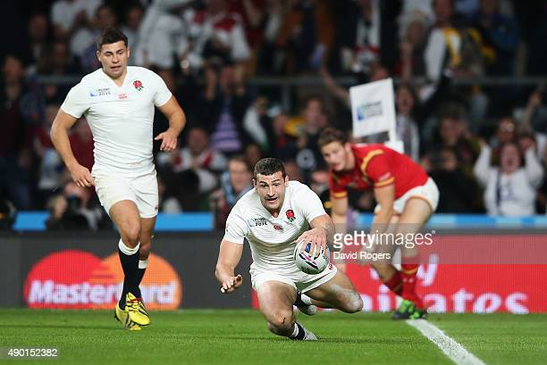 Jonny May of England scores the first England try during the 2015 Rugby World Cup Pool A match between England and Wales at Twickenham Stadium on...