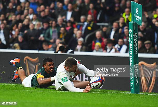 Jonny May of England scores the first try during the Old Mutual Wealth Series match between England and South Africa at Twickenham Stadium on...
