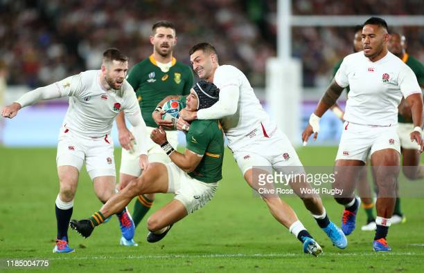 Jonny May of England tackles Cheslin Kolbe of South Africa during the Rugby World Cup 2019 Final between England and South Africa at International...