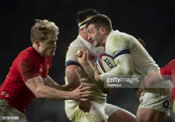 Jonny May of England takes on Aled Davies of wales during the NatWest Six Nations match between England and Wales at Twickenham Stadium on February...