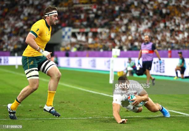 Jonny May of England touches down to score his team's first try as Izack Rodda of Australia runs in during the Rugby World Cup 2019 Quarter Final...