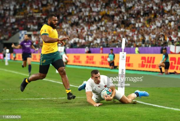 Jonny May of England touches down to score his team's second try as Samu Kerevi of Australia runs in during the Rugby World Cup 2019 Quarter Final...