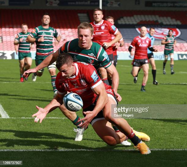 Jonny May of Gloucester beats Harry Potter to the loose ball during the Gallagher Premiership Rugby match between Gloucester Rugby and Leicester...