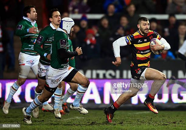 Jonny May of Gloucester breaks clear from Bastien Fuster of Bayonne to score a try during the European Rugby Challenge Cup match between Gloucester...
