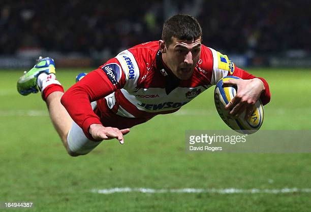 Jonny May of Gloucester dives over the line to score a try during the Aviva Premiership match between Gloucester and Harlequins at Kingsholm Stadium...