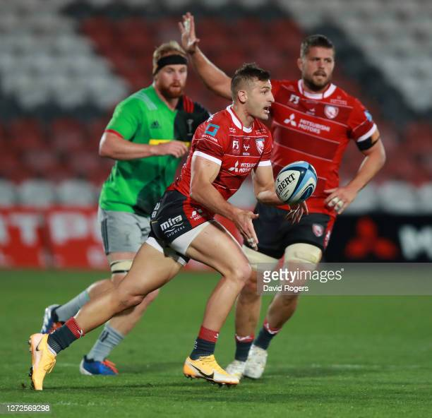 Jonny May of Gloucester off loads the ball during the Gallagher Premiership Rugby match between Gloucester Rugby and Harlequins at Kingsholm on...
