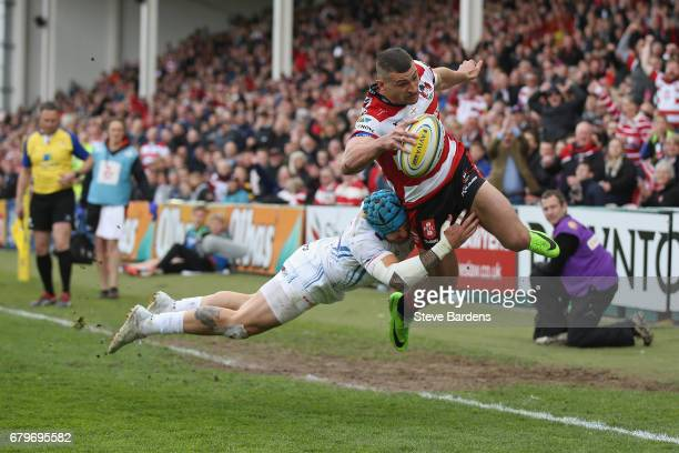 Jonny May of Gloucester Rugby is tackled by Jack Nowell of Exeter Chiefs during the Aviva Premiership match between Gloucester Rugby and Exeter...