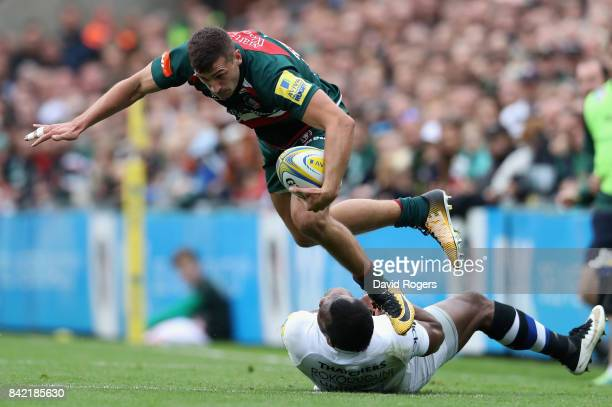 Jonny May of Leicester is tackled by Semesa Rokoduguni during the Aviva Premiership match between Leicester Tigers and Bath Rugby at Welford Road on...