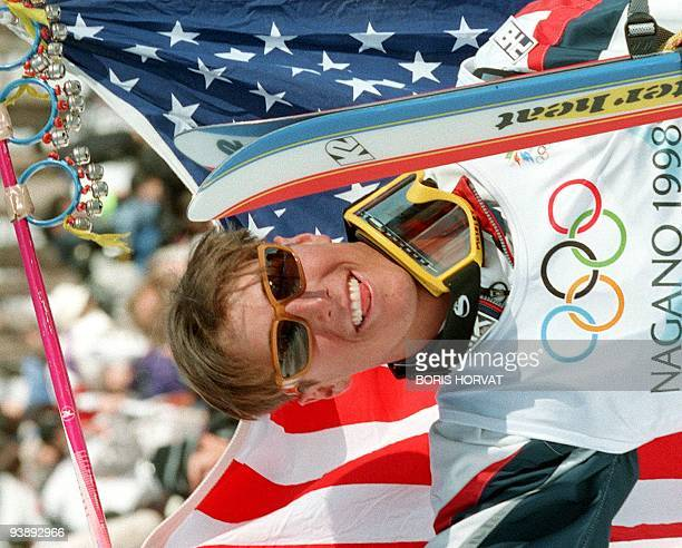 Jonny Moseley holds the US flag as he celebrates after winning the men's Olympic moguls freestyle skiing event at Lizuna Kogen near Nagano 11...