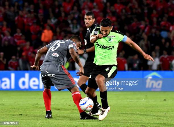 Jonny Mosquera of America de Cali vies for the ball with Andres Perez of Deportivo Cali during the match between America de Cali and Deportivo Cali...
