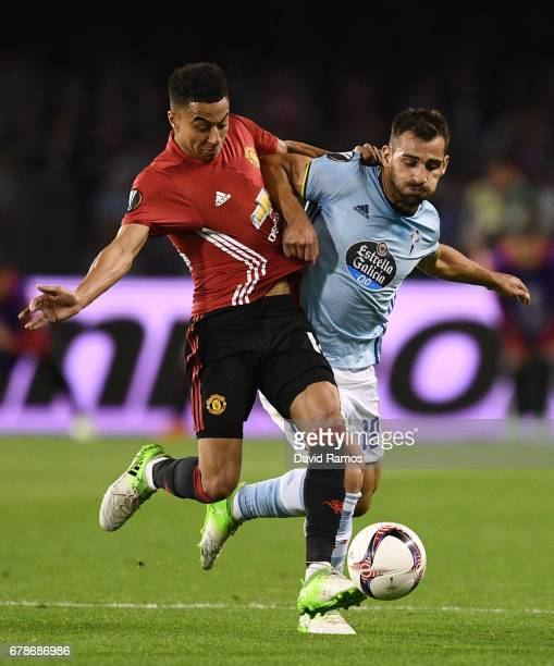 Jonny of Celta Vigo and Jesse Lingard of Manchester United battle for the ball during the UEFA Europa League semi final first leg match between Celta...