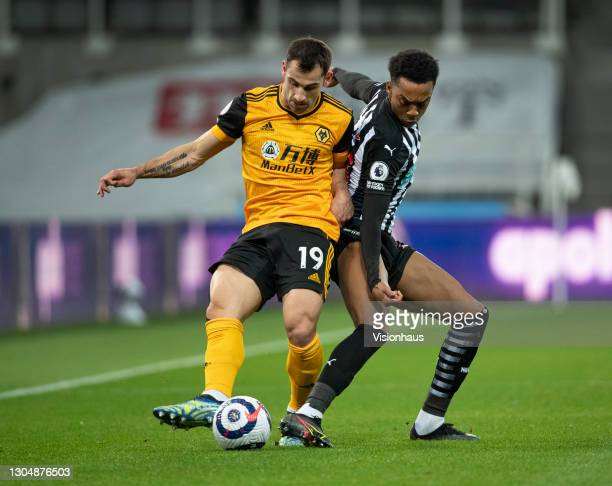 Jonny of Wolverhampton Wanderers and Joseph Willock of Newcastle United in action during the Premier League match between Newcastle United and...