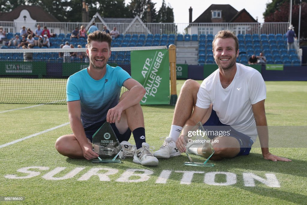 Jonny O'Mara (L) and Luke Bambridge of Great Britain pose for the camera after their victory against Ken Skupski and Neal Skupski of Great Britain during their Mens Doubles Final on Day 7 of the Fuzion 100 Surbition Trophy on June 8, 2018 in London, United Kingdom.