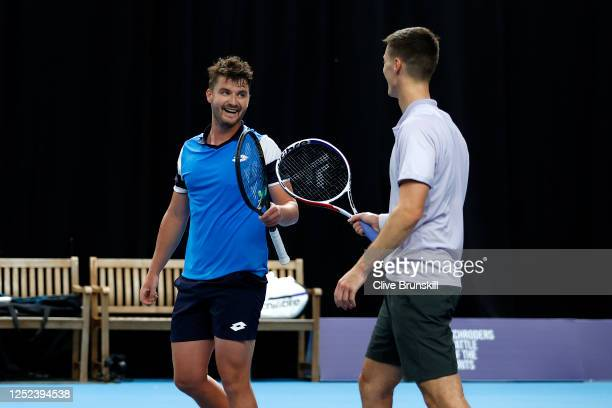 Jonny O'Mara celebrates victory with Joe Salisbury during their doubles match against Kyle Edmund and James Ward on day 3 of Schroders Battle of the...
