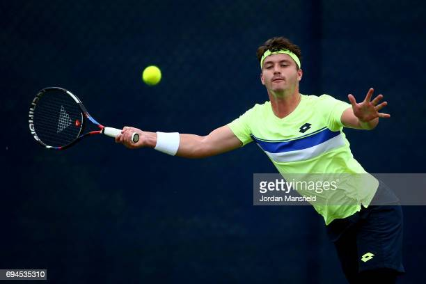 Jonny O'Mara of Great Britain reaches for a forehand during his match against Sam Groth of Australia during day one of Qualifying of the Aegon Open...