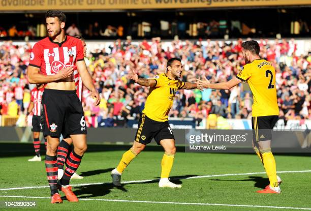 Jonny Otto of Wolverhampton Wanderers celebrates scoring his sides second goal with Matt Doherty as Wesley Hoedt of Southampton stands dejected...