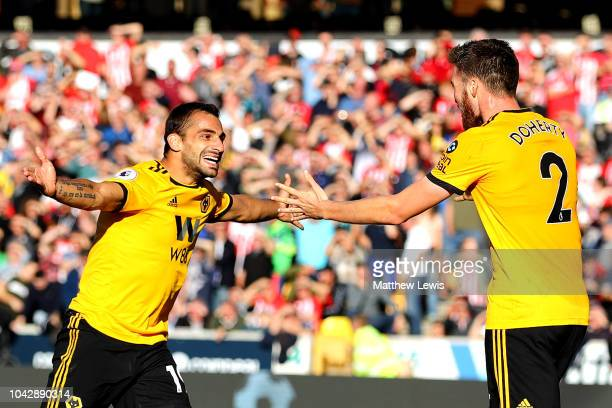 Jonny Otto of Wolverhampton Wanderers celebrates scoring his sides second goal with Matt Doherty during the Premier League match between...