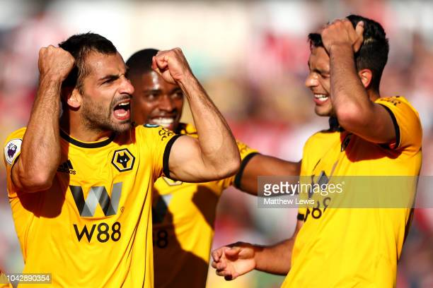 Jonny Otto of Wolverhampton Wanderers celebrates scoring his sides second goal with teammates during the Premier League match between Wolverhampton...