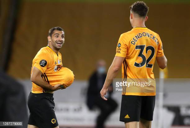 Jonny Otto of Wolverhampton Wanderers celebrates with teammate Leander Dendoncker of Wolverhampton Wanderers after scoring his team's second goal...