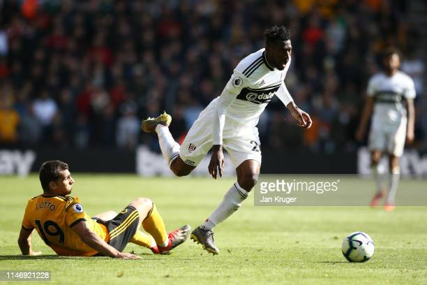 Jonny Otto of Wolverhampton Wanderers tackles AndreFrank Zambo Anguissa of Fulham during the Premier League match between Wolverhampton Wanderers and...