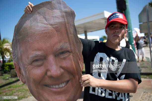 Jonny Riches and other supporters of former President Donald Trump gather along Southern Blvd near Trump's Mar-a-Lago home on February 15, 2021 in...
