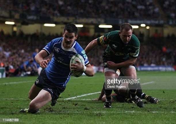 Jonny Sexton of Leinster dives over to score a try during the Heineken Cup Final match between Leinster and Northampton Saints at the Millennium...