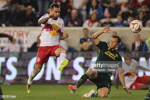 Jonny Steele New york Reds Bulls shoots past Jack Jewsbury Portland Timbers during the New York Red Bulls Vs Portland Timbers Major League Soccer...