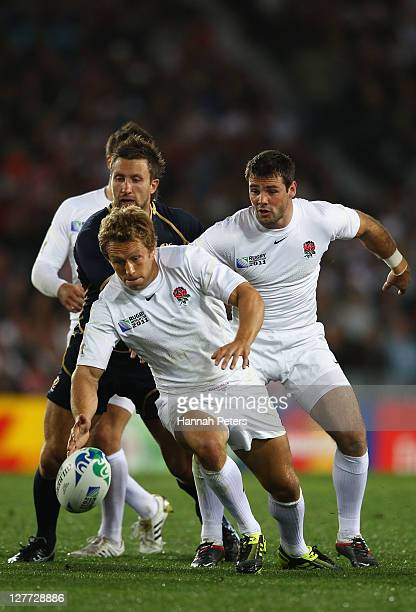 Jonny Wilkinson and Ben Foden of England fight for the ball with Simon Danielli of Scotland during the IRB 2011 Rugby World Cup Pool B match between...